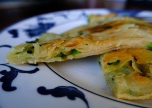 closeup of the layers of the scallion pancake